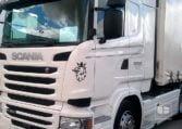 Scania R450 y remolque Tauliner (2016)